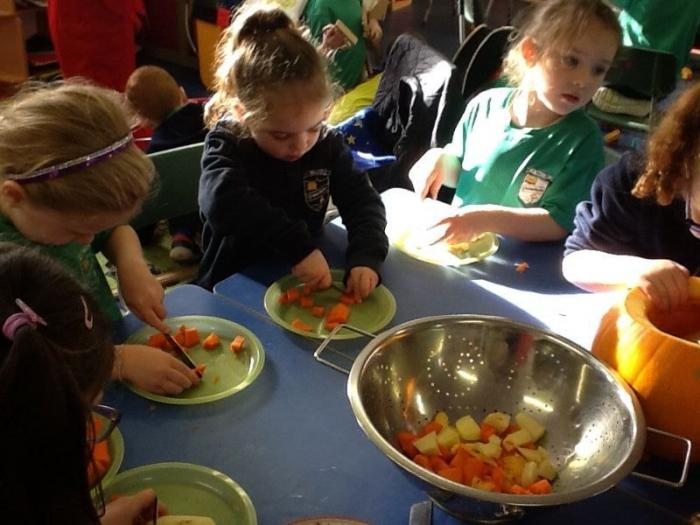 We are chopping potatoes,carrots,pumpkin and onions!